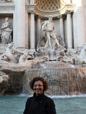 Artist Donna in front of fountains in Europe.