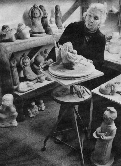Isabel Bloom in her studio creating a concrete sculpture