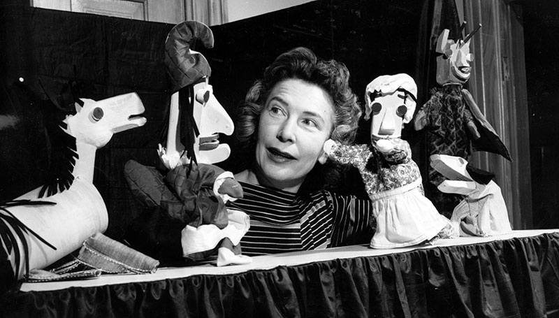 Isabel Bloom with clay created puppets